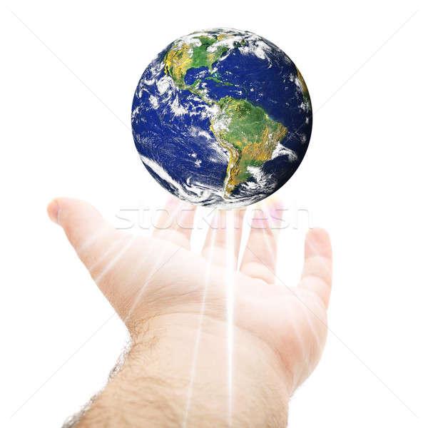 Mundo mão fora terra acima Foto stock © ArenaCreative