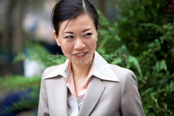 Asiático mulher de negócios atraente mulher traje de negócios feliz Foto stock © ArenaCreative