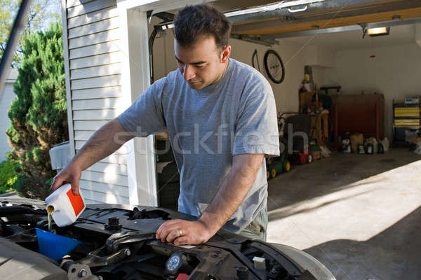 Stock photo: Man Changing the Oil
