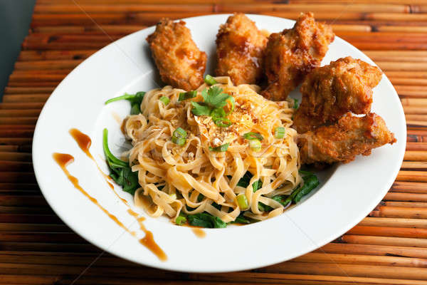 Stock photo: Chicken Wings with Noodles and Spinach
