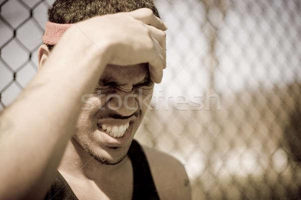 Sportowiec młodych czoło gniew ból Zdjęcia stock © ArenaCreative