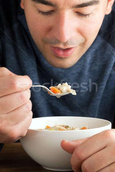 Uomo mangiare brodo di pollo caldo ciotola fresche Foto d'archivio © ArenaCreative