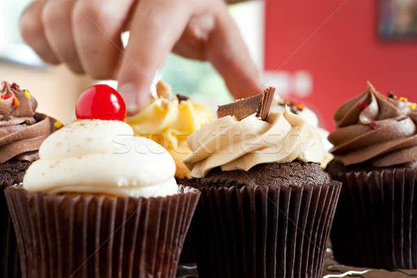 Hand Grabbing a Gourmet Cupcake Stock photo © ArenaCreative