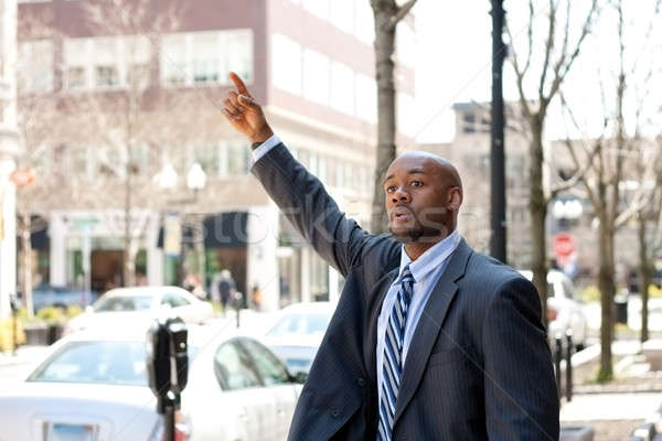 Business Man Hailing a Taxi Cab Stock photo © ArenaCreative