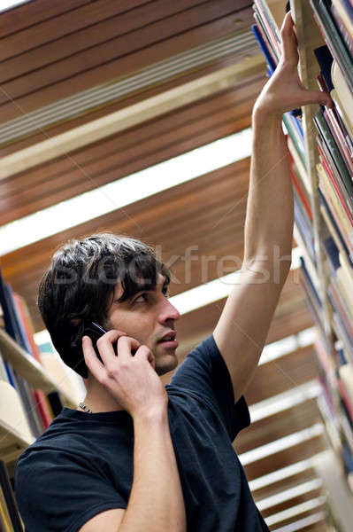 Man Searching at the Library Stock photo © ArenaCreative
