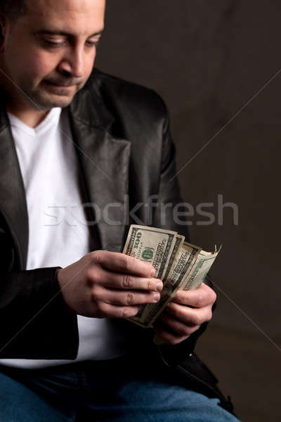 Man Counting Cash Stock photo © ArenaCreative