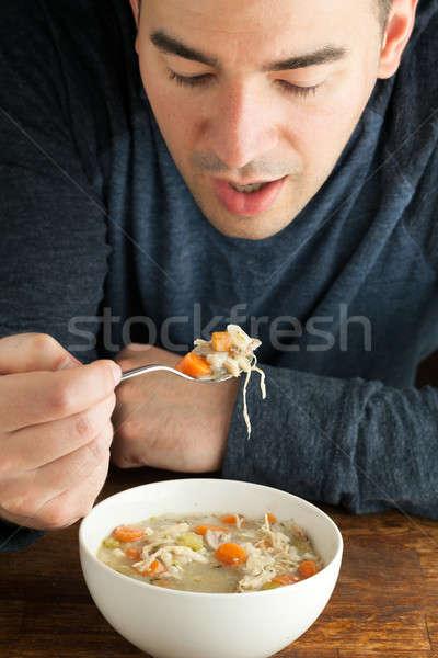 Uomo mangiare fatto in casa brodo di pollo caldo ciotola Foto d'archivio © arenacreative