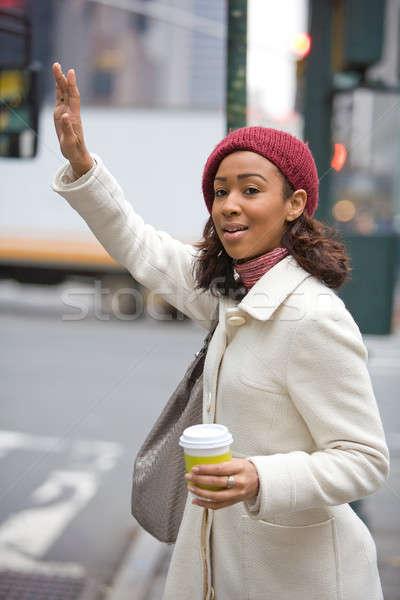 Woman Hailing A Cab Stock photo © ArenaCreative