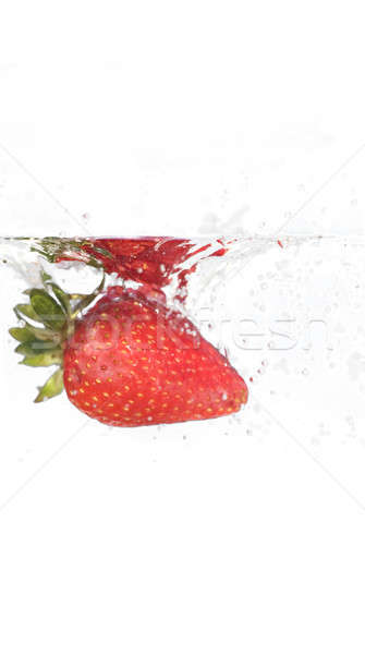 Strawberry In Water Stock photo © ArenaCreative