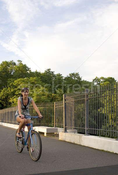Dziewczyna rowerów młoda kobieta jazda konna rower sportu Zdjęcia stock © ArenaCreative