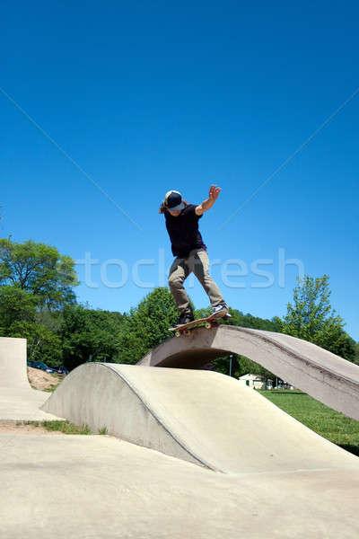 Skateboarder Grinding at the Skate Park Stock photo © ArenaCreative