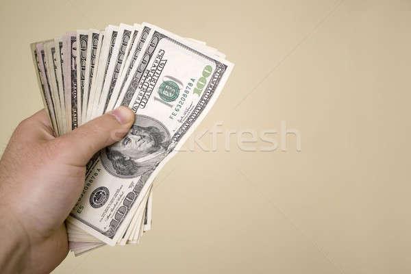 Geld cash geïsoleerd goud hand achtergrond Stockfoto © ArenaCreative