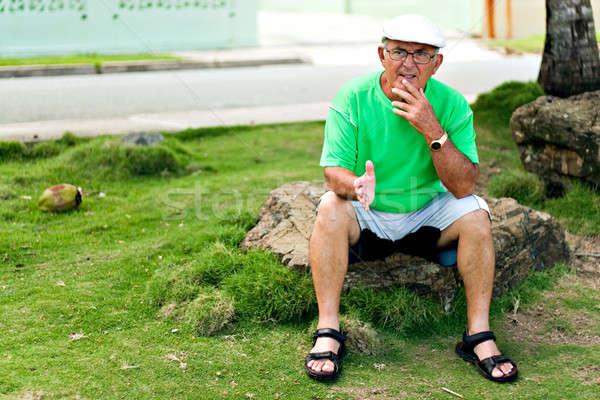 Hispânico senior homem ao ar livre Foto stock © ArenaCreative