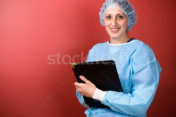 Jonge gezondheidszorg professionele poseren solide Rood Stockfoto © ArenaCreative
