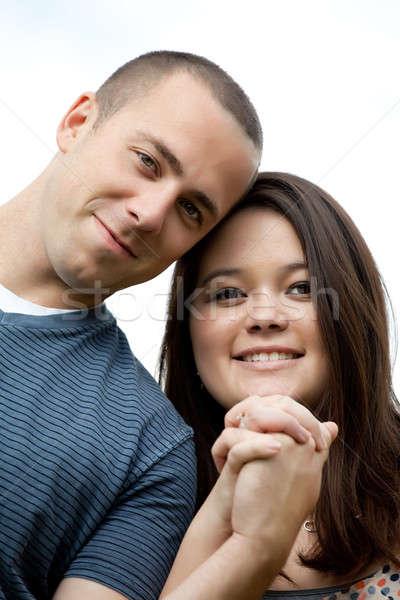 Happy Interracial Married Couple Stock photo © ArenaCreative