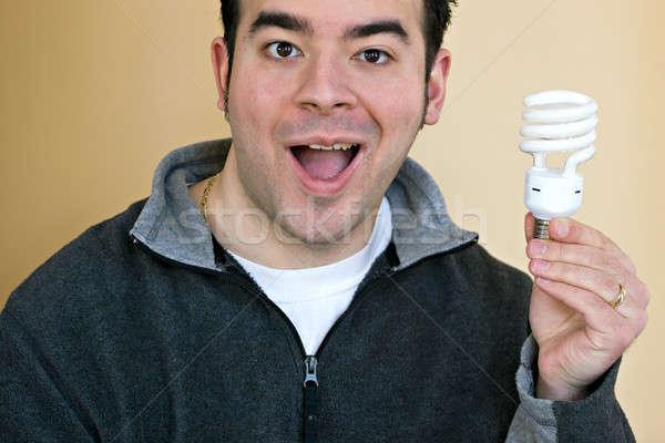 Kompakt floresan ampul genç enerji Stok fotoğraf © ArenaCreative