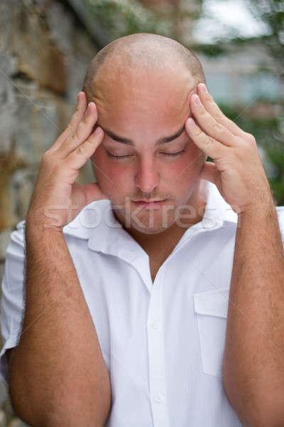 Pijnlijk hoofdpijn uit jonge man hoofd Stockfoto © ArenaCreative