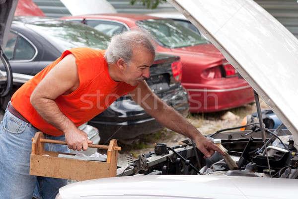 Man Junk Yard Hunting Stock photo © ArenaCreative