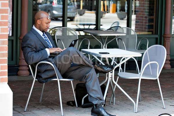 Business Man Working on His Laptop Outdoors Stock photo © ArenaCreative