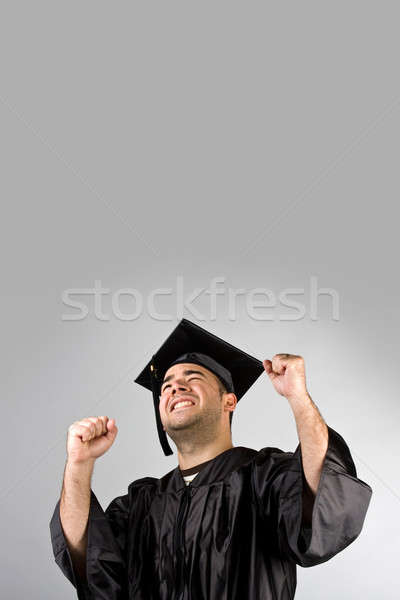Happy Graduate Celebrating Stock photo © ArenaCreative