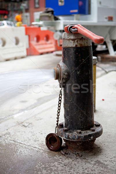 Fire Hydrant Spraying Water Stock photo © ArenaCreative