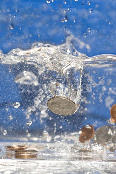 Para aşağı boşaltmak madeni para havuz su Stok fotoğraf © ArenaCreative