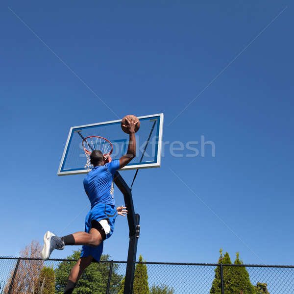 Basketball Player Slam Dunking Stock photo © ArenaCreative