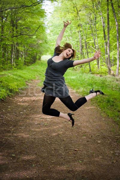 Joyful Jumping Woman Stock photo © ArenaCreative