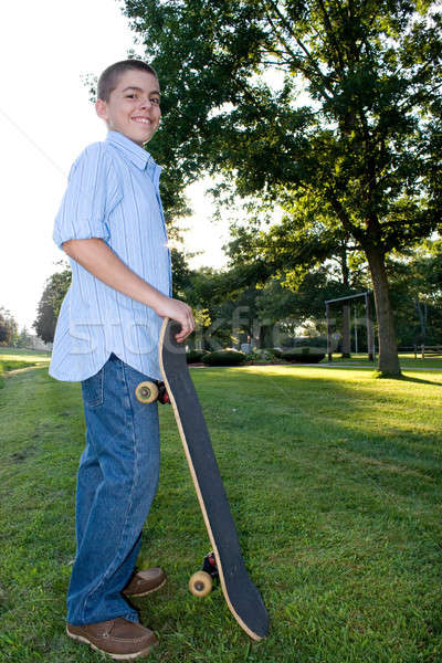 Boy with Skateboard Stock photo © ArenaCreative
