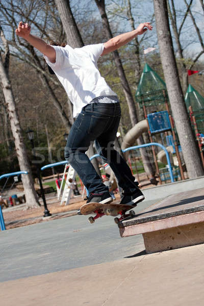 Stock photo: Male Skateboarder Grinding