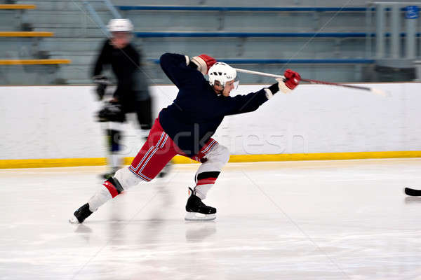 Hockey Player Shooting Stock photo © ArenaCreative