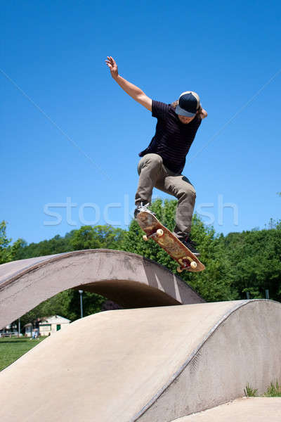 Stock photo: Skateboarder Doing a Jump at a Concrete Skate Park
