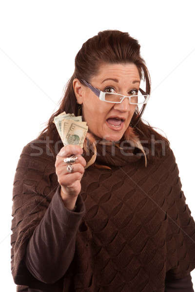 Woman Holding Money Stock photo © ArenaCreative