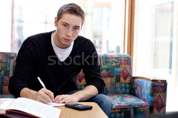 Male College Student Doing His Homework Stock photo © ArenaCreative