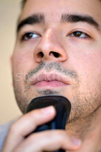 Young Man Shaving Stock photo © ArenaCreative