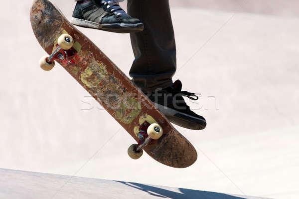Stock photo: Skateboarder Jumping Tricks