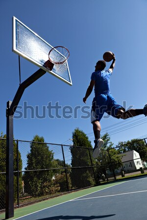 Kosárlabdázó sziluett fiatal felfelé hát fényes Stock fotó © arenacreative