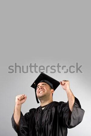 Happy Graduate Celebrating Stock photo © ArenaCreative