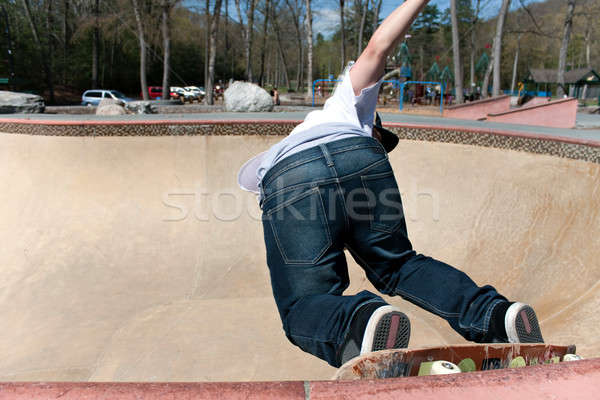 Stock photo: Skateboarder Skating the Bowl