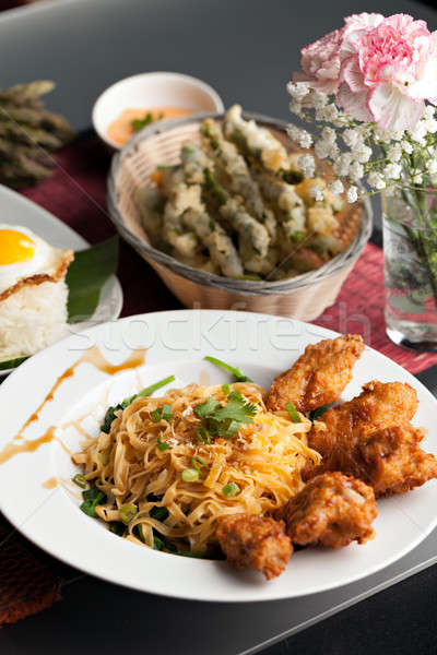 Thai Fried Chicken Wings with Noodles Stock photo © arenacreative