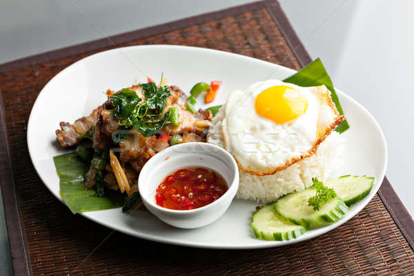 Stock photo: Thai Crispy Pork with Fried Egg
