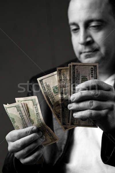 Man Counting Cash Stock photo © ArenaCreative