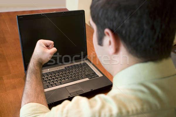 Estúpido computador jovem homem de negócios frustrado laptop Foto stock © ArenaCreative