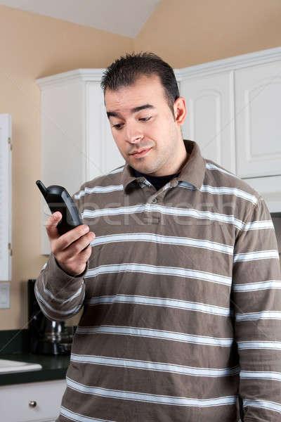 Man Holding Cordless Phone Stock photo © ArenaCreative