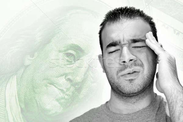 Estressante economia moço cabeça angústia dinheiro Foto stock © ArenaCreative