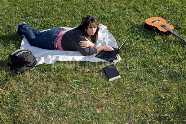 Woman Using a Laptop Stock photo © ArenaCreative