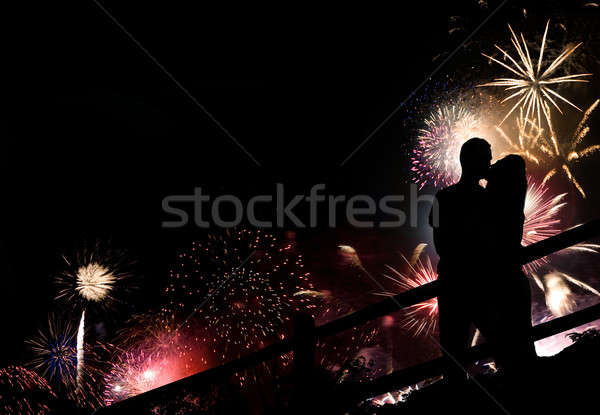 Fuochi d'artificio Coppia silhouette bacio enorme display Foto d'archivio © ArenaCreative