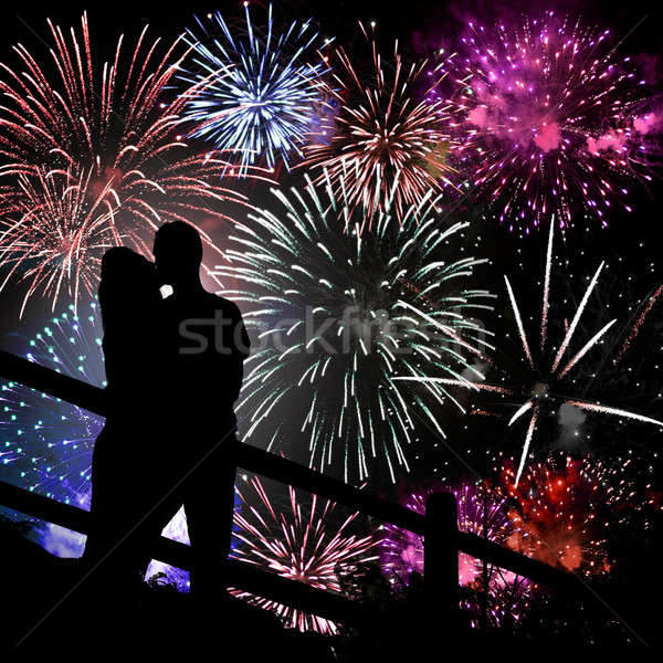 Feux d'artifice silhouette baiser couple énorme écran Photo stock © ArenaCreative