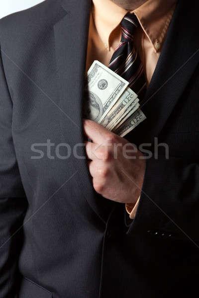 Desonesto empresário negócio mão ocultação Foto stock © ArenaCreative