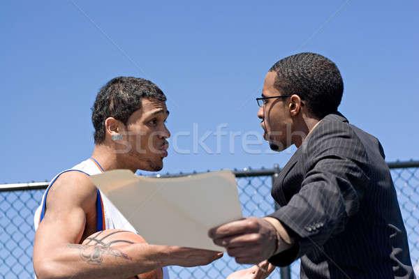 Zangado basquetebol treinador jovem homem Foto stock © ArenaCreative